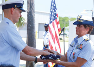 Coast Guard Hands Flag