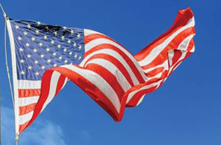 Jumbo Beautiful American Flag On A Flying Against A Sky