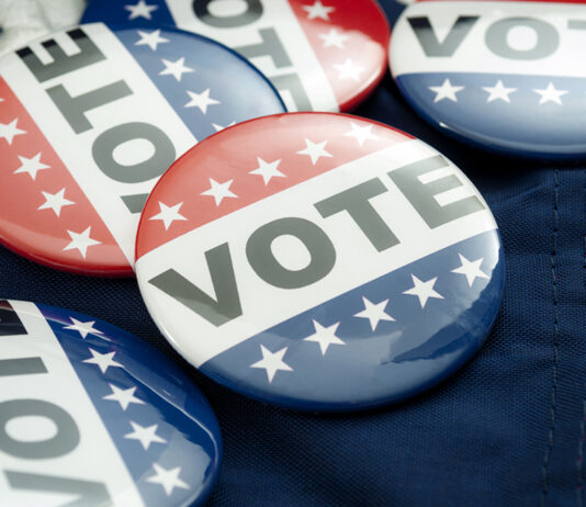 Democrat Vs Republican Poll, Democratic Decision And Primary Voting Conceptual Idea With Vote Election Campaign Button Badges And The United States Of American Flag