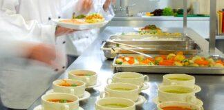 Four,chefs,working,in,a,modern,kitchen,preparing,soups