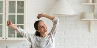 Happy Millennial Woman Have Fun Cooking Breakfast In Kitchen