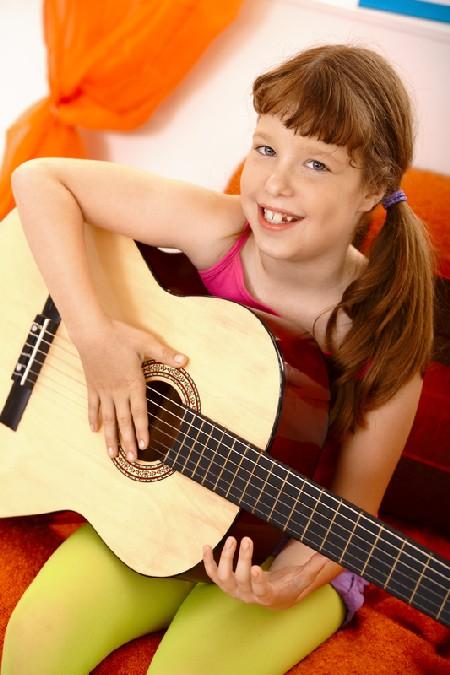 Cute Schoolgirl With Guitar